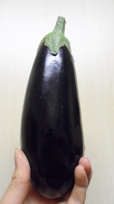 No, it's not a big aubergine - it's just a freakishly small hand
